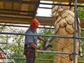 Close up of Paul using a chain saw; an unusual tool for sculpting